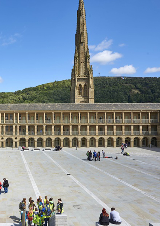 The piece hall courtyard, with the church spire in the background.