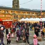 A busy Christmas market in the courtyard.