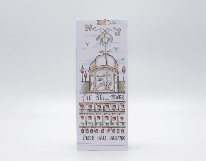 Handcrafted bell tower bookmark.