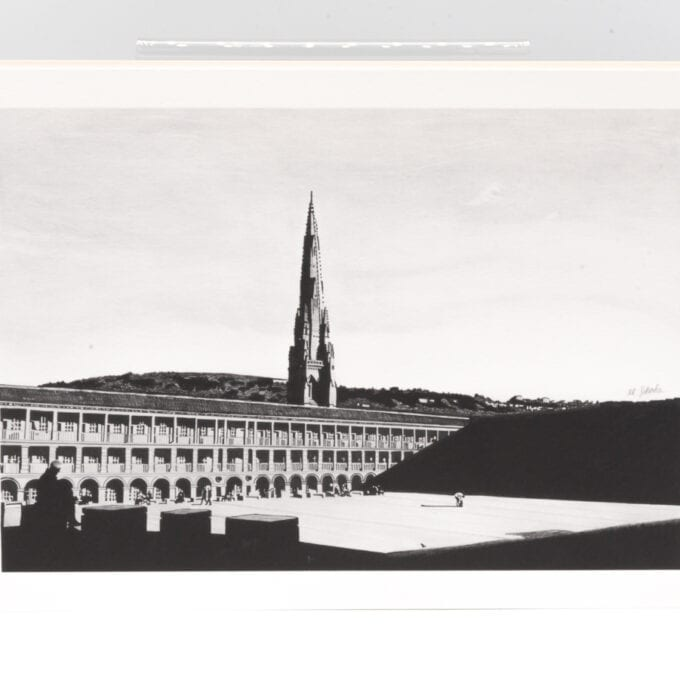 The piece hall in grey-scale, with the church spire in the background.