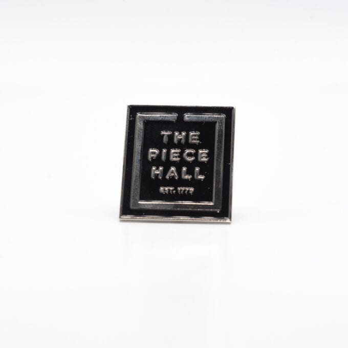 The piece hall pin in black.