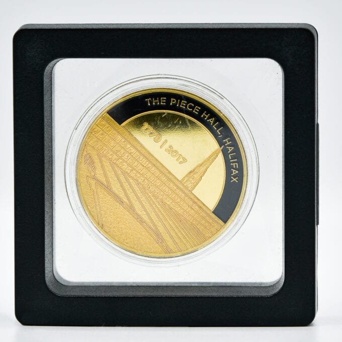 The piece hall coin, displayed in case.