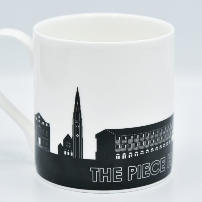 The piece hall bone china cup with silhouetted piece hall design.