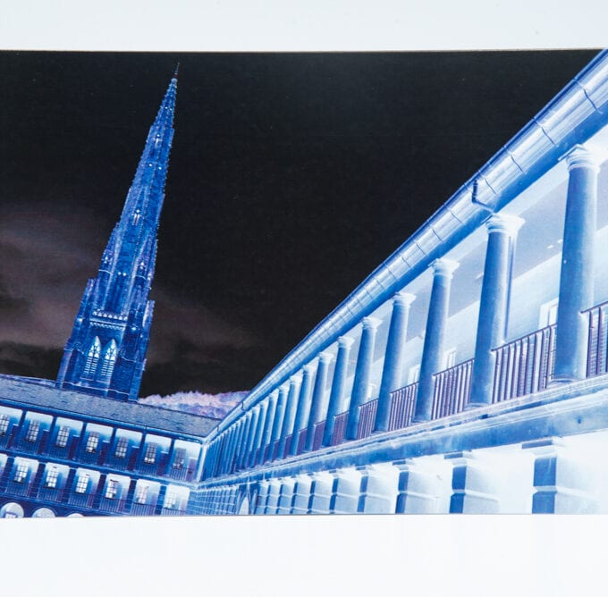 Negative image of courtyard and church spire.