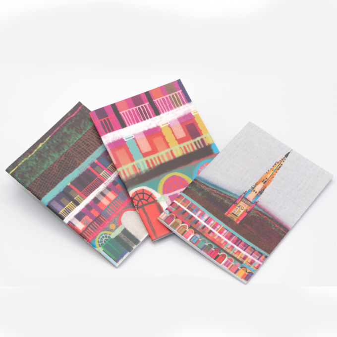 3 pack of notebooks, depicting a multicoloured piece hall on the covers.