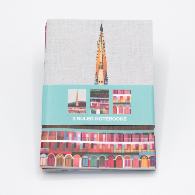 3 pack of notebooks, depicting a multicoloured piece hall on the cover.