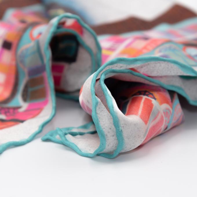 A multicoloured piece hall design on a silk scarf.