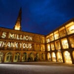 The piece hall courtyard, with lighting display to show '5 MILLION THANKYOU'S' on the wall, celebrating 5 million visitors.