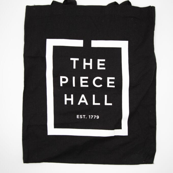 The piece hall tote bag in black.